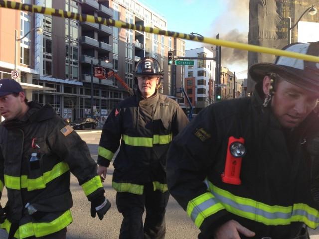 Firefighters cross over Channel Street. (Jeremy Raff/KQED)