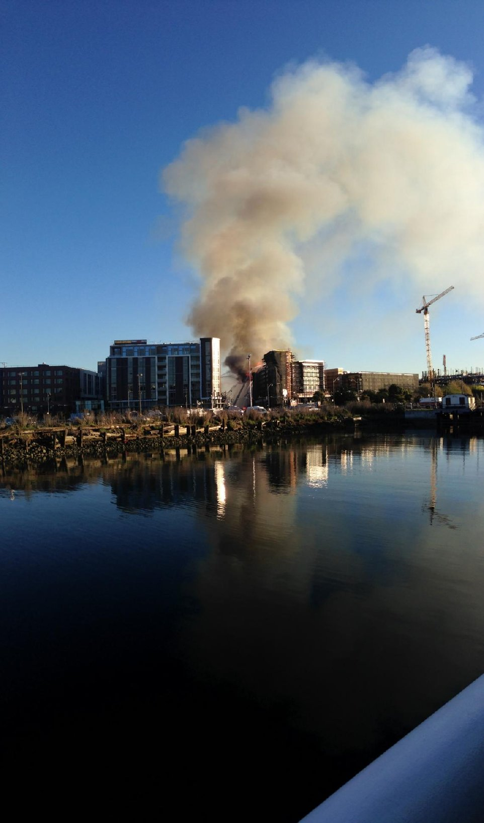 Residents around the Bay Area could see smoke from the five-alarm blaze at Fourth Street and China Basin. (Jeremy Raff/KQED)