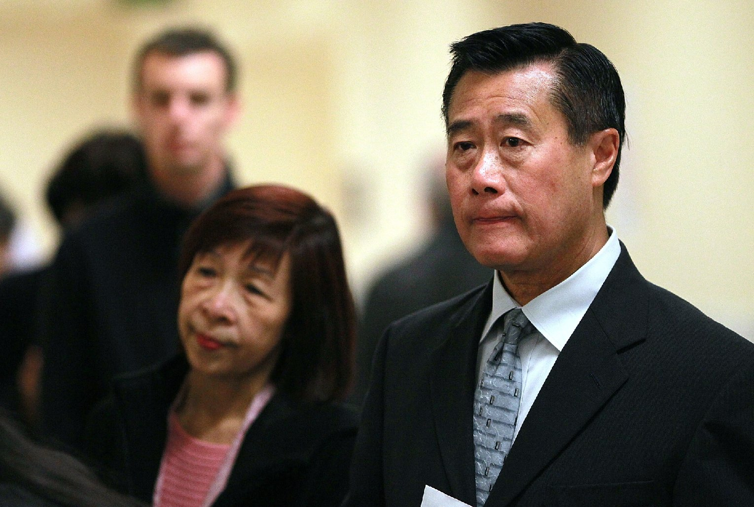 California state Sen. Leland Yee and his wife, Maxine Yee, wait to cast their ballots in San Francisco in November 2011. (Justin Sullivan/Getty Images)