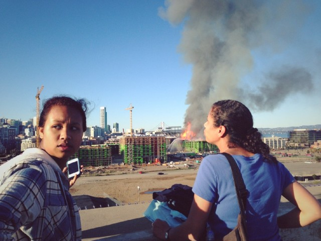 People watch the China Basin fire from afar. (Jeremy Raff/KQED)