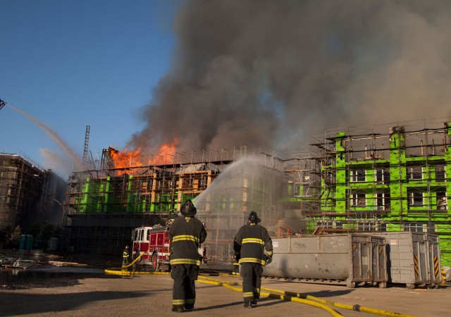 San Francisco firefighters respond to the fire at Fourth and China Basin streets on March 11. (KQED)