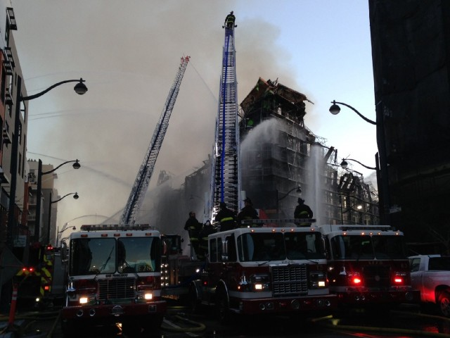 Firefighters work to contain a five-alarm fire at Fourth and China Basin streets in Mission Bay. (Charla Bear/KQED)
