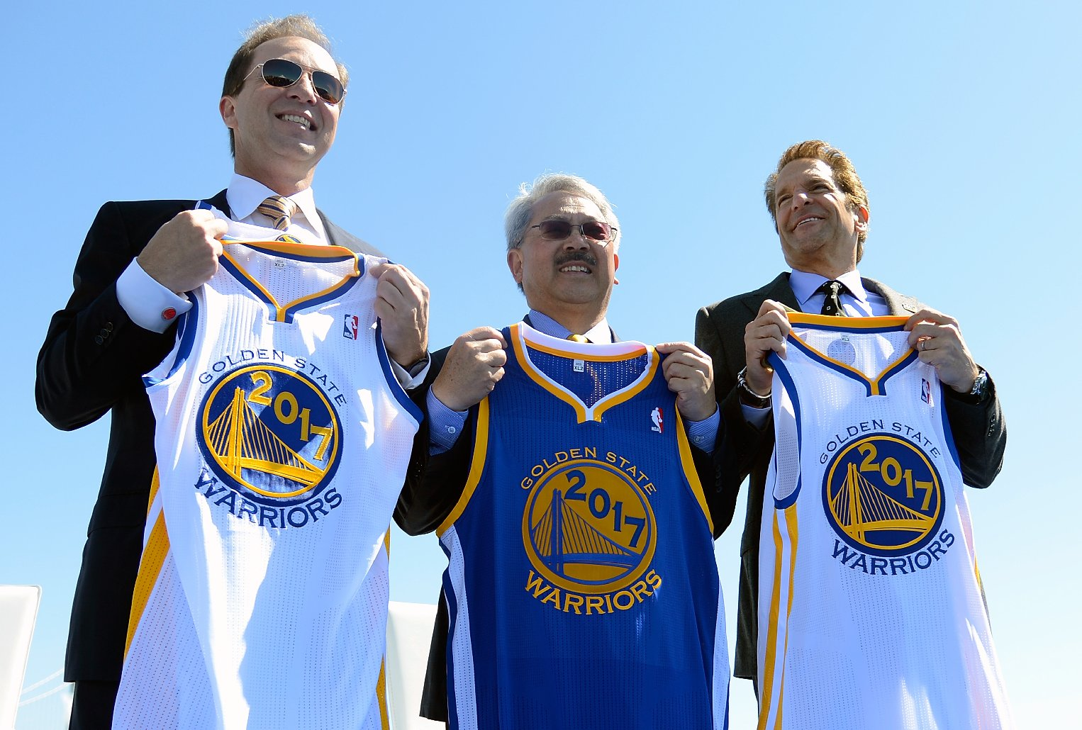 Co-Executive Chairman & CEO, Golden State Warriors Joe Lacob, San Francisco Mayor Edwin M. Lee, and Co-Executive Chairman of the Golden State Warriors Peter Guber poses together for this photo at a press conference. (Co-Executive Chairman & CEO, Golden State Warriors Joe Lacob, San Francisco Mayor Edwin M. Lee, and Co-Executive Chairman of the Golden State Warriors Peter Guber poses together for this photo at a press conference (Thearon W. Henderson/Getty Images)