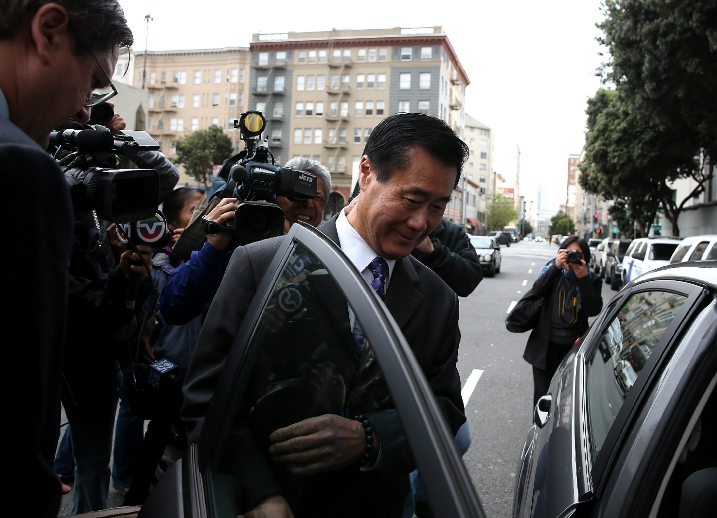 State Sen. Leland Yee gets into an awaiting car as he leaves the Phillip Burton Federal Building after a court appearance on March 31, 2014 (Justin Sullivan/Getty Images).