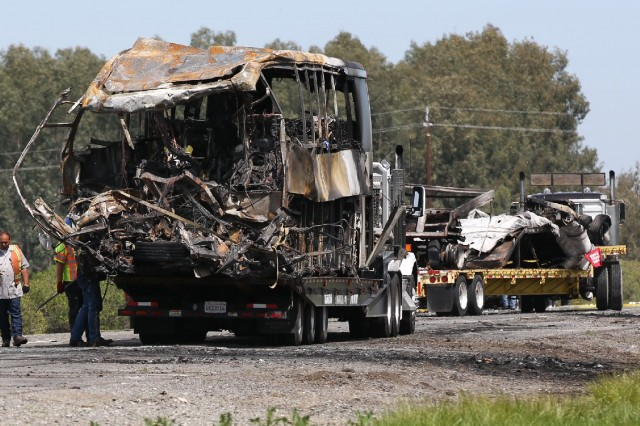 Wreckage of bus and truck involved in collision and fire on Interstate 5 in the Sacramento Valley town of Orland. (Elijah Nouvelage/Getty Images)