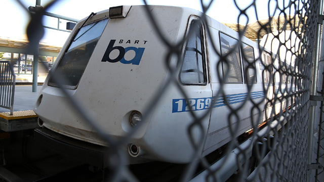 A BART train sits idle at the Millbrae station during the BART strike last July. (Justin Sullivan/Getty Images)