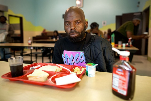 Calvin Henderson is one of many homeless people who sleep in the chairs at Mother Brown's (Mark Andrew Boyer / KQED)
