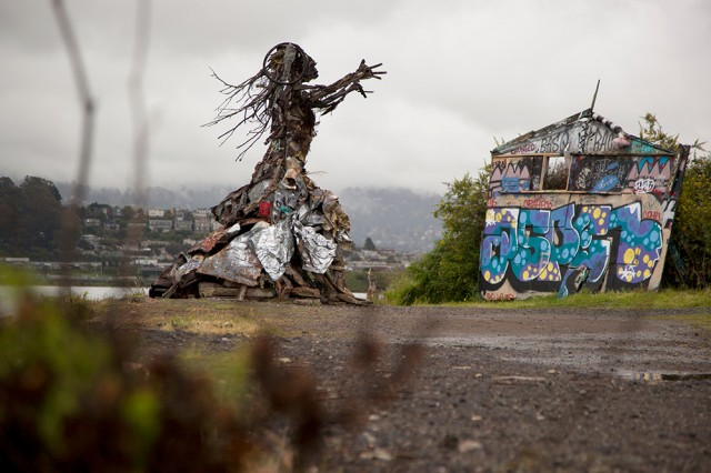Sculptures created by artist and lawyer Osha Neumann stand on the shore of the Albany Bulb. (Mark Andrew Boyer/KQED)