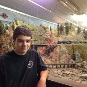 Nicholas Wright and the Golden Gate Model Railroad Club layout. (Cyrus Musiker/KQED)