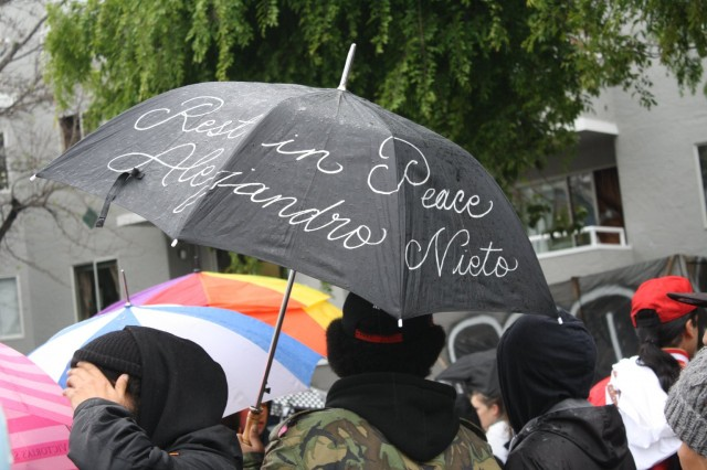 About 500 people marched in the rain Saturday, March 29, from San Francisco's Mission District to Bernal Heights Park, where 28-year-old Alejandro Nieto was shot and killed by police officers a week before. (Alex Emslie/KQED)