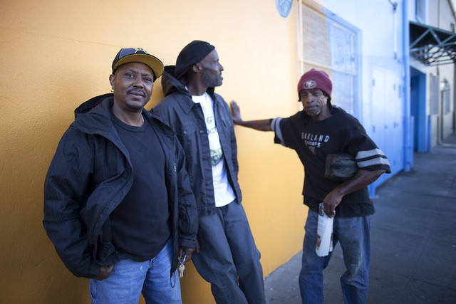 Clients of Mother Brown's Dining Room hang out in front of the soup kitchen. (Mark Andrew Boyer/KQED)