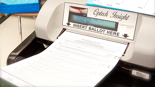 Ballot scanning machine,  November 6, 2012. (Lisa Pickoff-White/KQED)