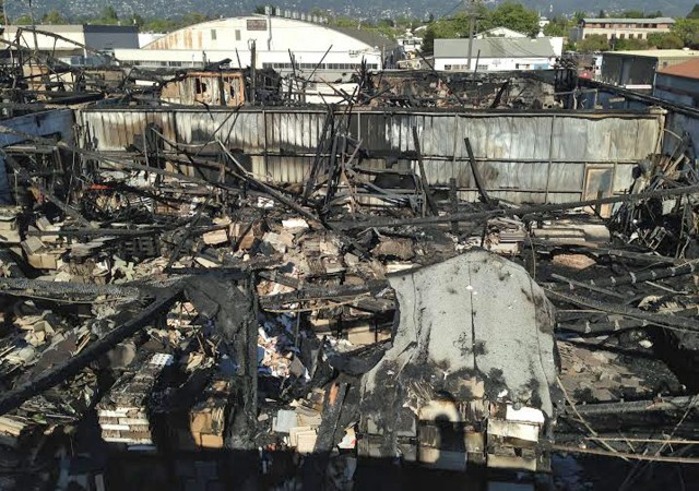 The remains of The Wooden Duck warehouse, as seen from above, after a five-alarm fire Saturday, April 12. Some of the businesses at the location on Berkeley's Eastshore Highway survived largely intact, but 20 artisans whose equipment and crafts were housed in the same building complex lost everything. (Todd Forbush/Berkeleyside)