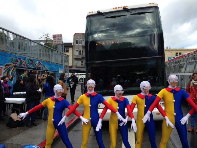 Protesters delay a Google bus in the Mission today. (Photo by Zach Mack)