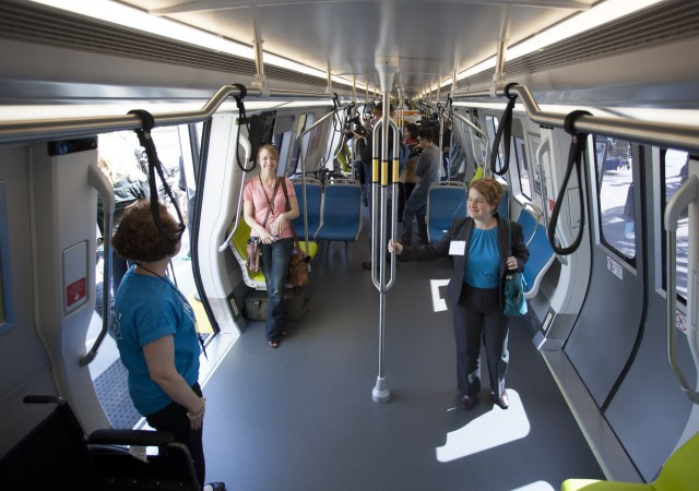 "BART unveiled its ""Fleet of the Future"" train cars on Wednesday, April 16, inviting the public to tour a model train in downtown San Francisco. The car was greeted with mixed reviews. The most pointed criticism came from riders with disabilities, who argued that the design provides less accessibility for disabled passengers. (Mark Andrew Boyer/KQED)"