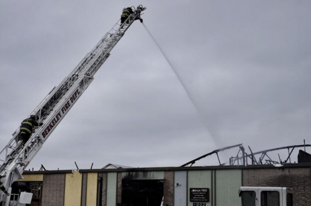 Firefighters continued to dose the building with water on Sunday morning, April 13. (Pete Rosos/Berkeleyside)