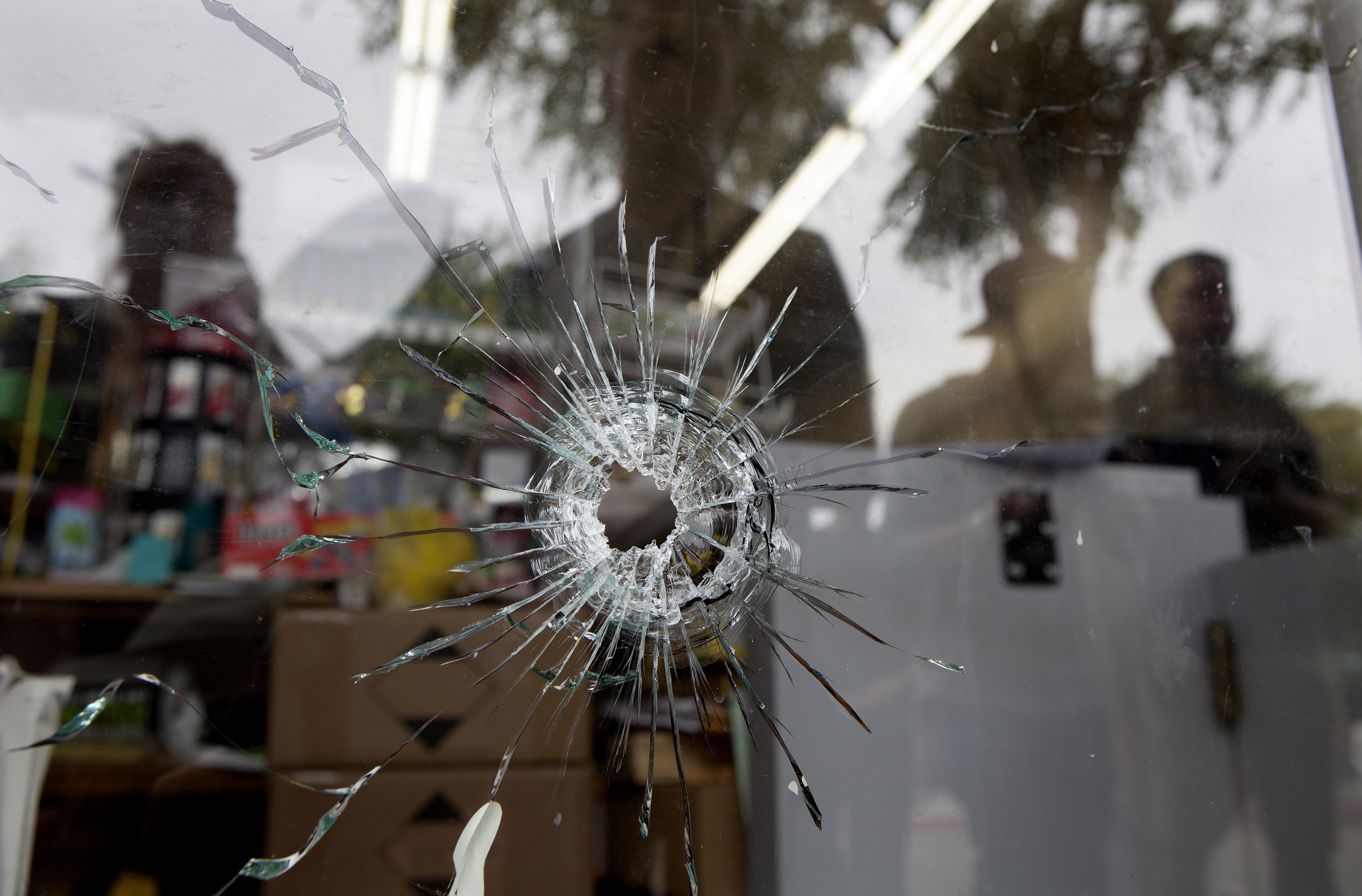 Bullet holes in the IV Deli Mart, one of several crime scenes Saturday, May 24, 2014. (Spencer Weiner/Getty Images)
