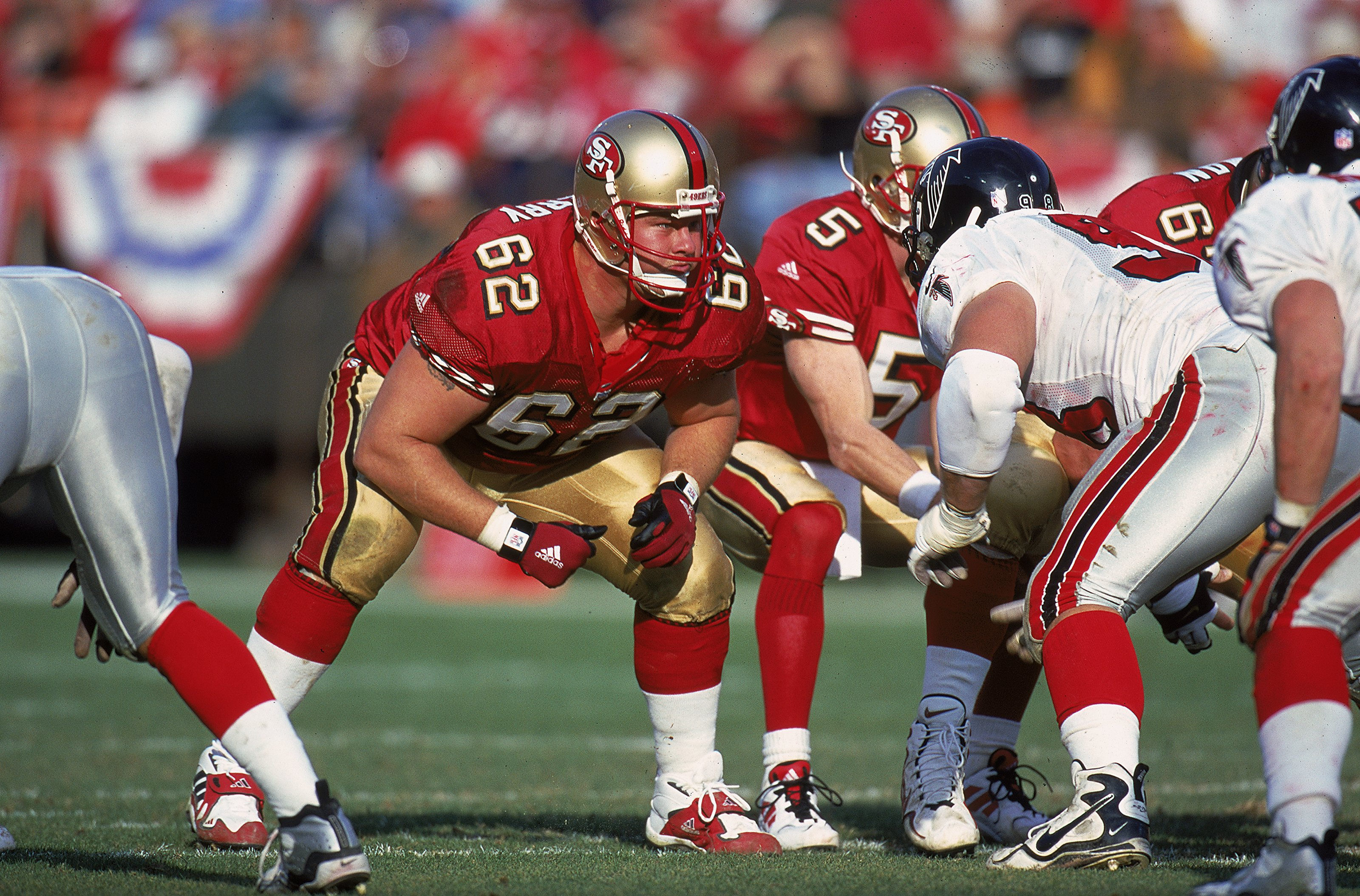 San Francisco 49ers offensive lineman Jeremy Newberry, No. 62, in a 1999 NFL game. Newberry is one of the plaintiffs in a class-action lawsuit alleging NFL teams misuse powerful painkillers to keep injured players on the field. (Tom Hauck/Allsport-Getty Images)
