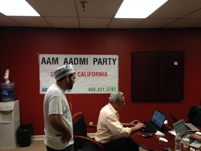 Parwaz Virk, left, and Dilawar Chahal volunteer for the Aam Aadmi Party, making phone calls to India to ask people for their votes from Chahal's office in Sunnyvale Friday, May 9. (Samantha Clark/KQED)