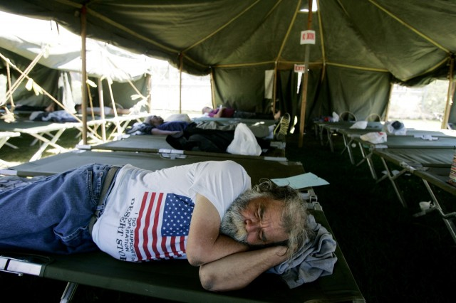 A homeless veteran sleeps in a tent in San Diego in 2007. (Sandy Huffaker/Getty Images)