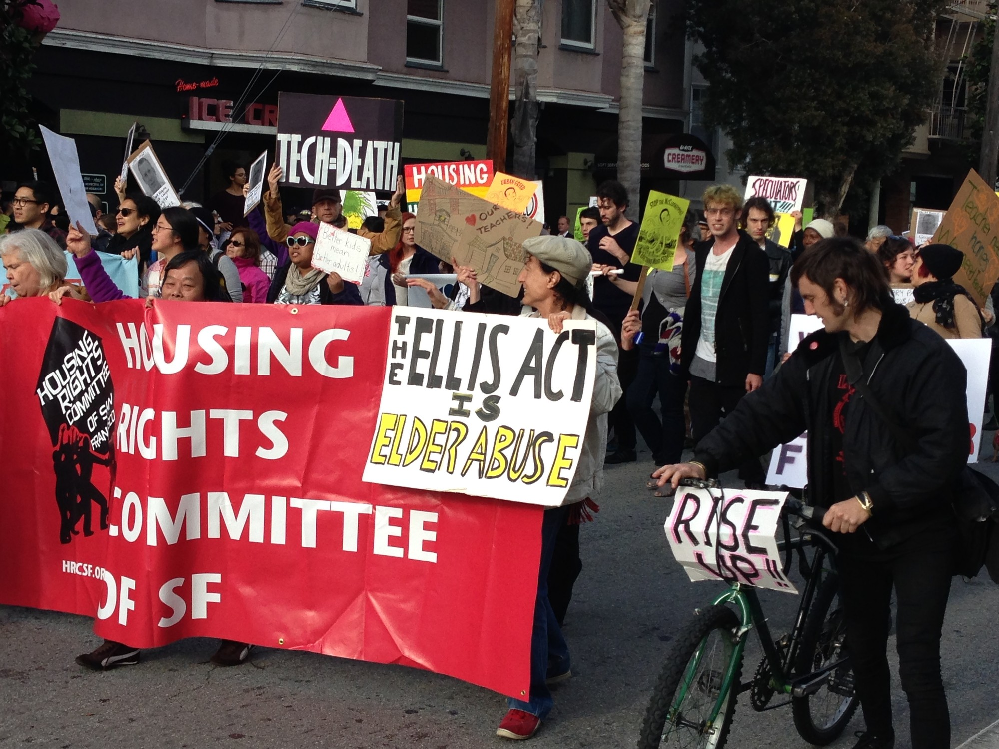 Tenant Rights groups protest evictions outside the San Francisco headquarters of a real estate firm in December 2013. (PeterLollo/KQED)
