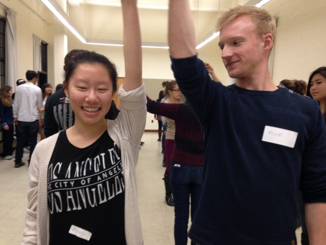 Two students practice a California twirl at UC Berkeley's square dancing class, run by students. (Samantha Clark/KQED)