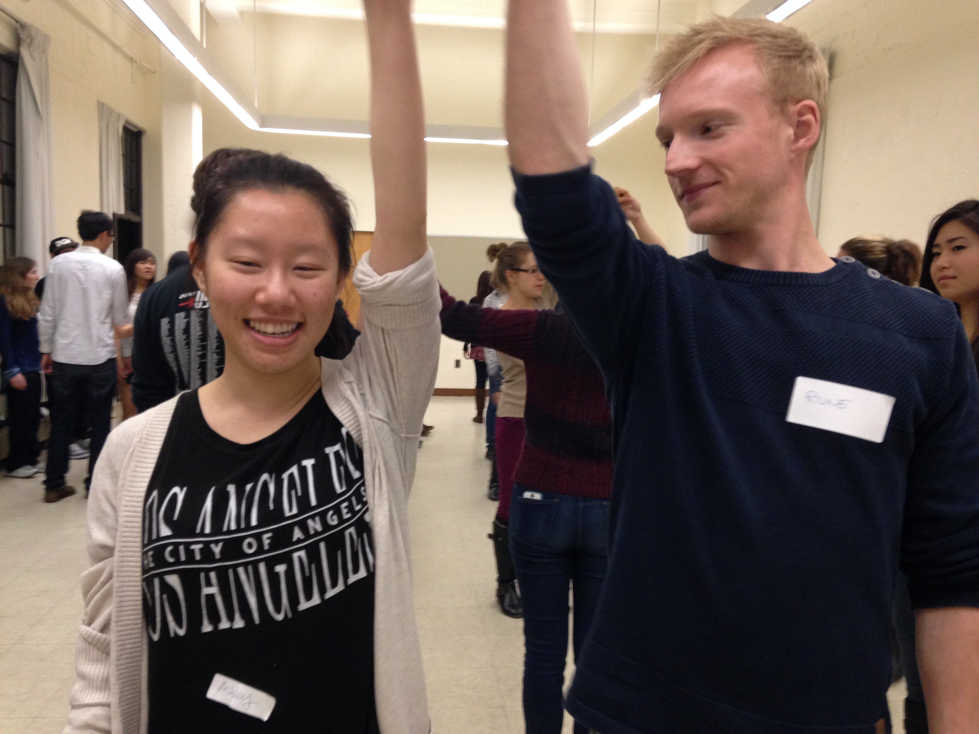 Two students practice a California twirl at UC Berkeley's square dance student-ran class. (Samantha Clark/KQED)