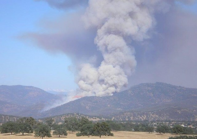 On Monday, smoke rose from the Hunters Fire near Lake McClure in Mariposa County. (Carol Barrentez via Twitter)