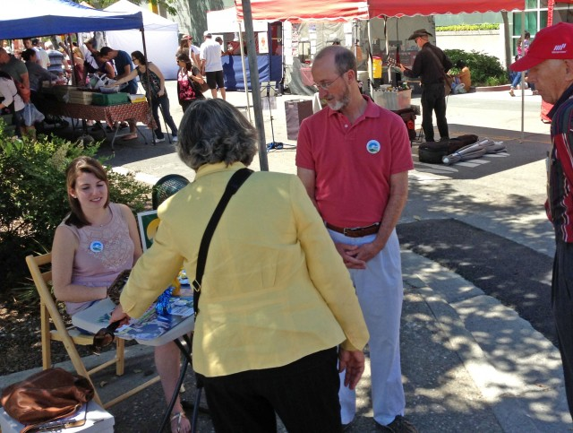 Candidate Steve Glazer and daughter Alex talk to voters at the Walnut Creek farmer's market. (Cy Musiker/KQED)