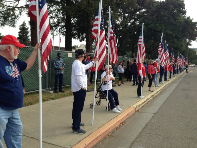 Protesters outside Live Oak High School in Morgan Hill on Monday morning. (Francesca Segre/KQED)