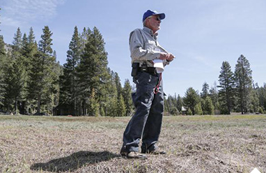 Frank Gehrke, chief snow surveyor for the California Department of Resources, talks to reporters after May 1 survey found only a snowless meadow. (Zack Cunningham/DWR)