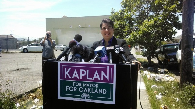 Rebecca Kaplan announces her run for mayor of Oakland from a garbage-strewn sidewalk on International Boulevard. (Andrew Stelzer / KQED)