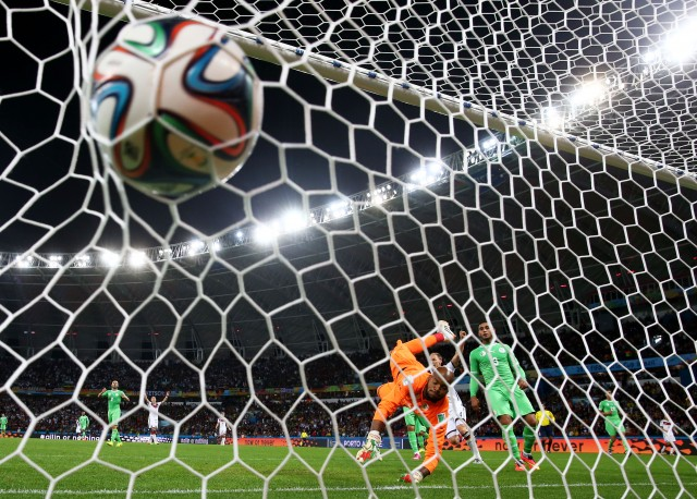 ais M'Bolhi of Algeria fails to save a shot by Andre Schuerrle of Germany (Julian Finney/Getty Images)