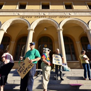 Community members protest the proposed sale of the Berkeley Post Office in 2012.(Daniel Parks/Berkeleyside)
