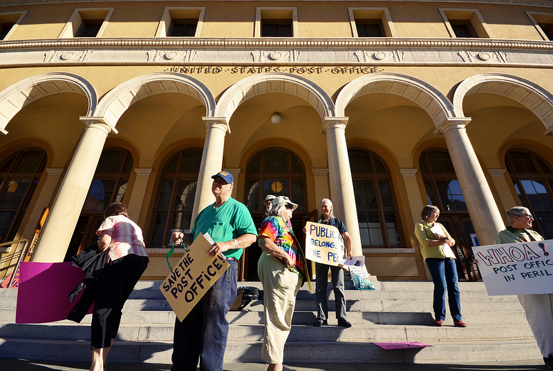 A Berkeley developer plans to turn the city's main Post Office into a retail operation while retaining postal services. A vocal group of Berkeley residents have been fighting the post office closure since 2012. (Daniel Parks/Berkeleyside)