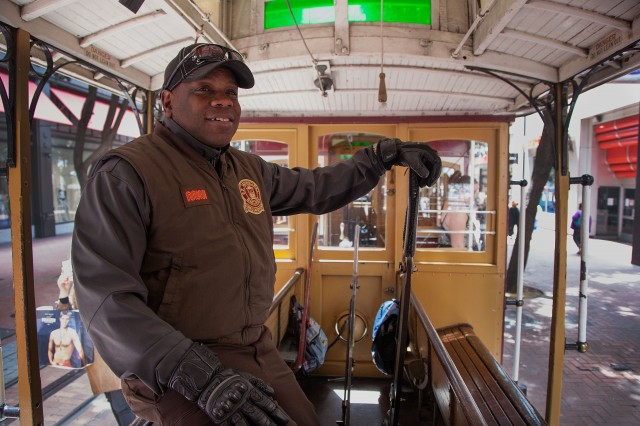 Cable car conductor Francis Givens, 51, of Brentwood, works on the Powell Street line. (Mark Andrew Boyer/KQED)