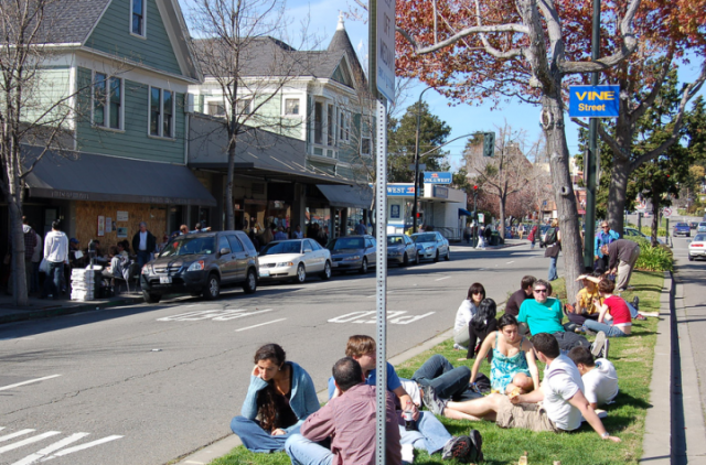 People routinely eat on the Shattuck Avenue median near the Cheese Board. New parklets might change that. (Jason/Flickr)