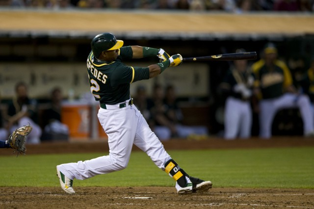A's outfielder Yoenis Cespedes, traded to the Boston Red Sox on Thursday. (Jason O. Watson/Getty Images)