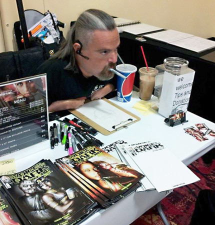Larime Taylor signs his artwork for fans at Comic-Con in San Diego. (Courtesy Mark Walsh)