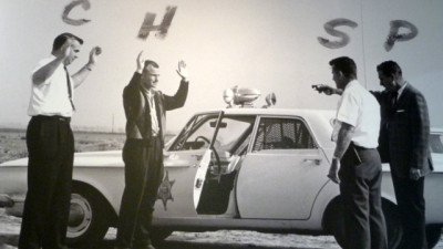 LAPD officers reenact the 1963 Onion Field shooting on location, just days after the incident. (Courtesy Los Angeles Police Museum)