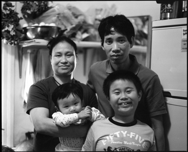 Family living in a residential hotel in Chinatown, San Francisco. (James Hosking & Jeremy Lybarger/The Bold Italic)