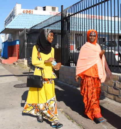 Isha Aweyso and her mother, Nuriya Abshiro walk through the Little Mogadishu district of City Heights in San Diego. (Brian Myers/Media Arts Center San Diego)