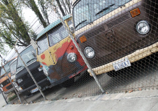 A wide variety of VW buses can be seen in the garage lot of Buslab. (Alejandro Rosas/KQED)