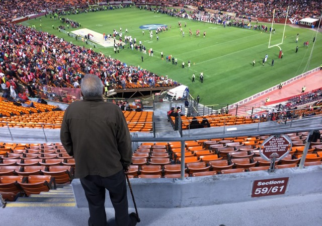 John Barberini of Hayward watches the Legends of Candlestick flag football game, an event featuring former San Francisco 49ers greats against a team of retired NFL stars. It was billed as the final football game at the stadium, now slated for demolition next year. (Dan Brekke/KQED)