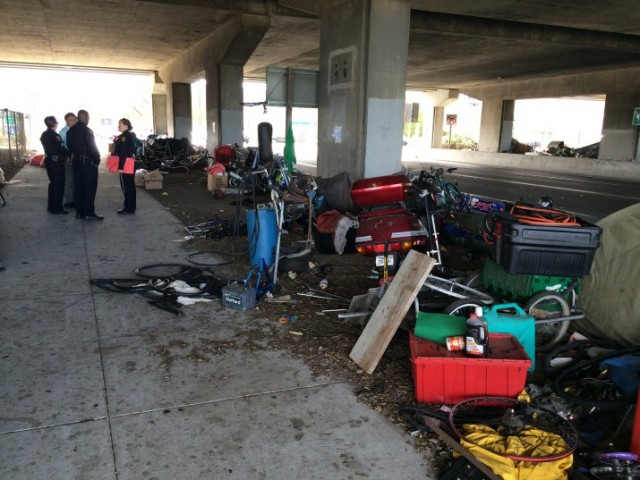 Berkeley police have been visiting the homeless camp on Gilman Street — pictured here in early July — to provide outreach.  (Drew Jaffe/Berkeleyside)