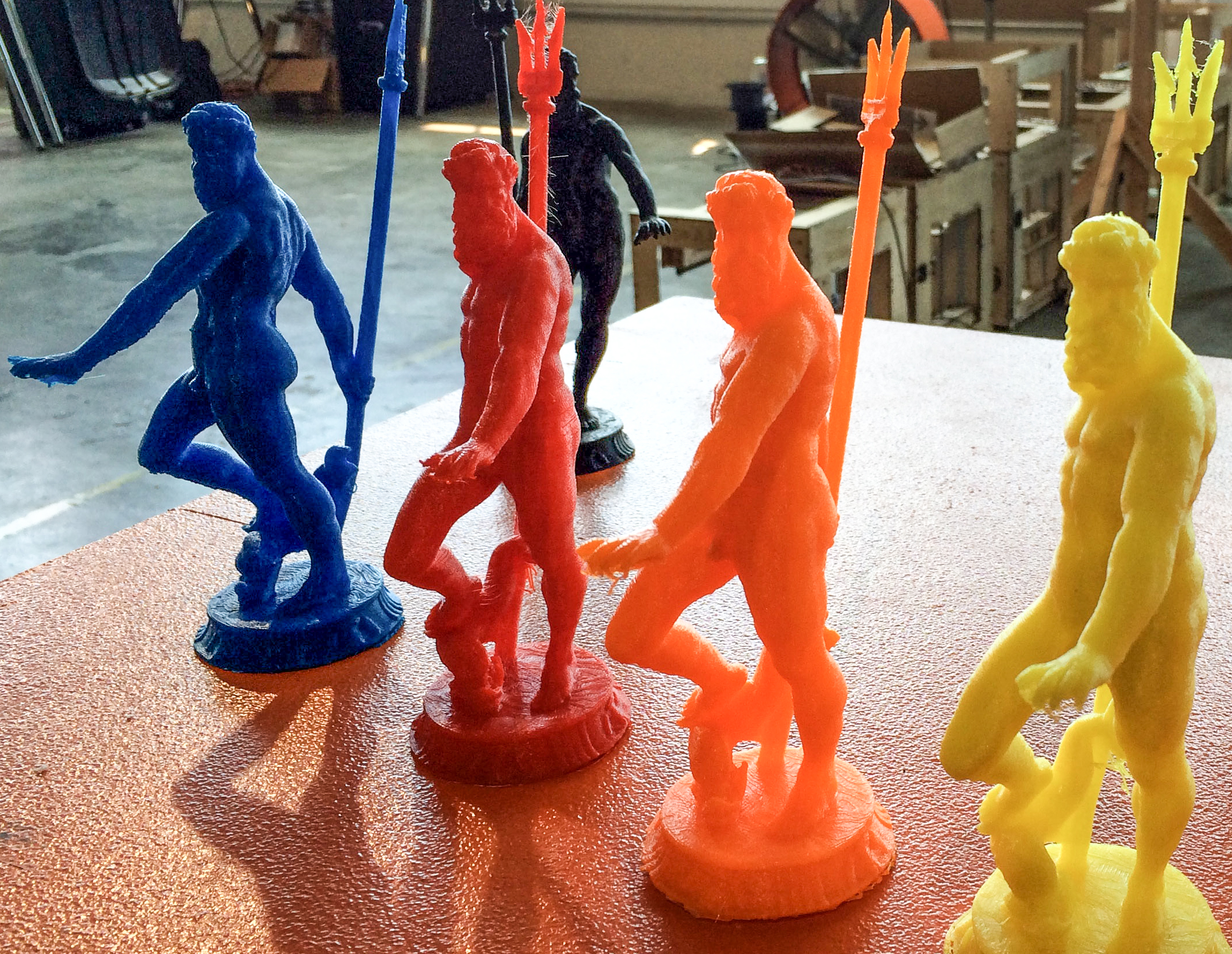 Figurines of the god Neptune made in Type A Machines' production space in San Leandro. (Aaron Mendelson/KQED)