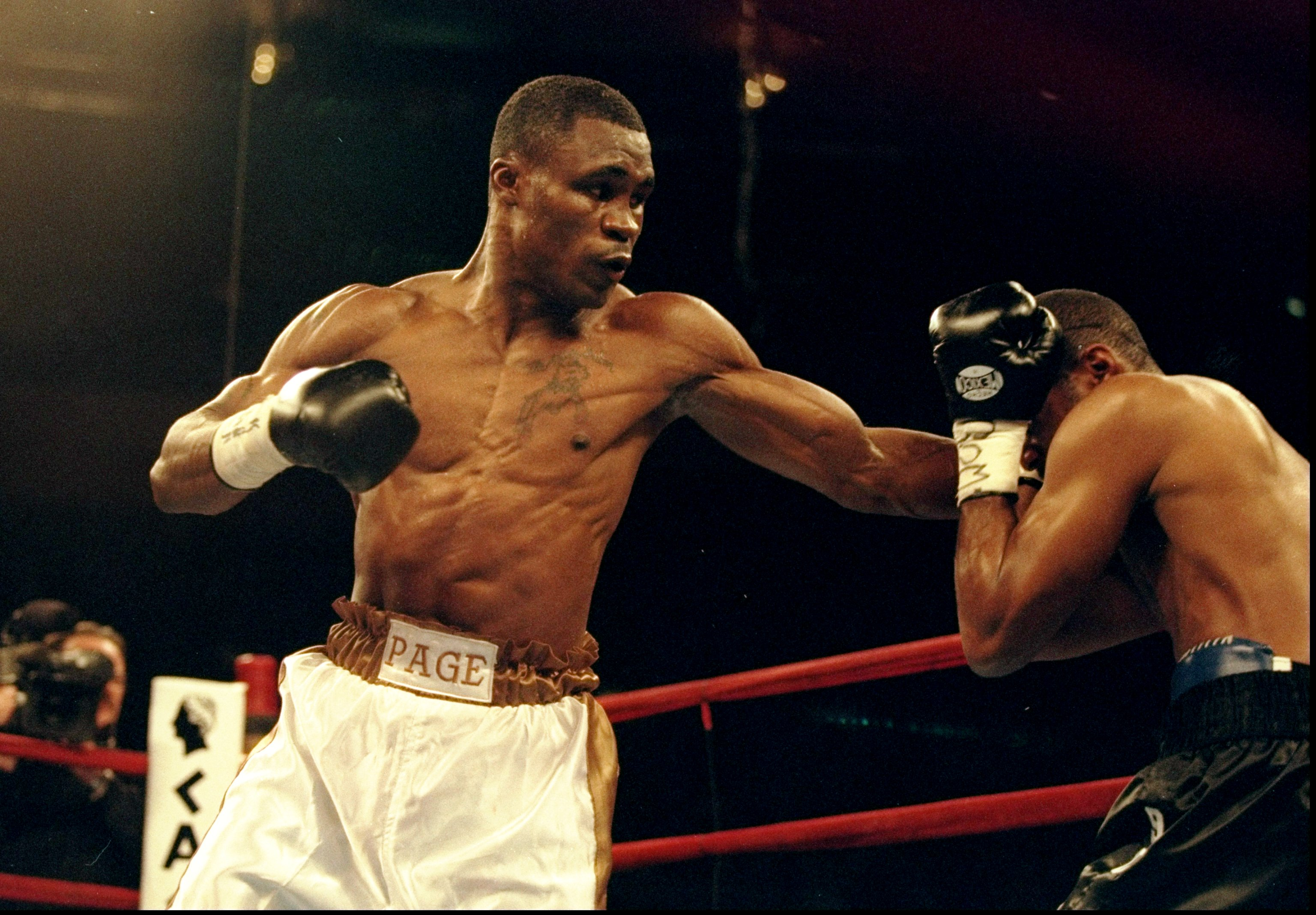 James Page, left, in a 1999 welterweight bout against Sam Garr. (Al Bello/Getty Images)