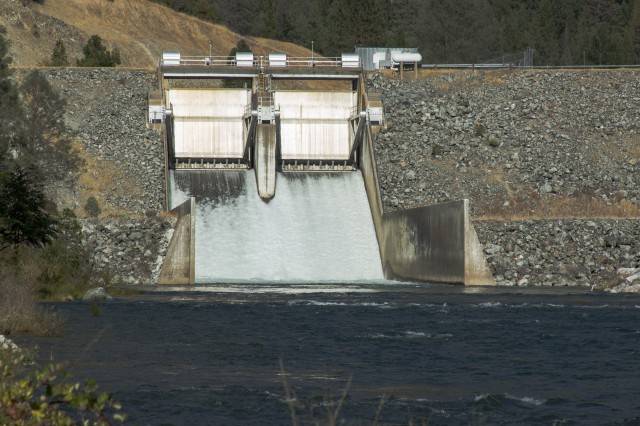 Water pounds down the spillway from Lewiston Dam on the Trinity River. The U.S. Bureau of Reclamation is increasing flows to aid migrating salmon. (Dan Brekke/KQED)