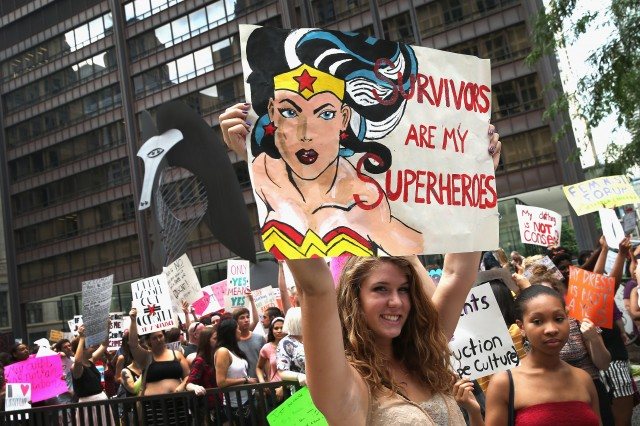 "Protestors march at ""slut walks"" around the country to raise awareness around consent and sexual assault. (Scott Olson/Getty Images)"