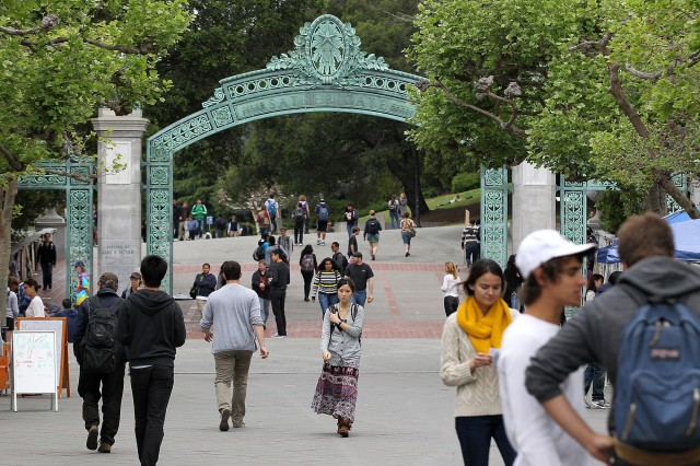 UC Berkeley students walk through Sproul Plaza on the UC Berkeley campus in April 2012. (Photo by Justin Sullivan/Getty Images)